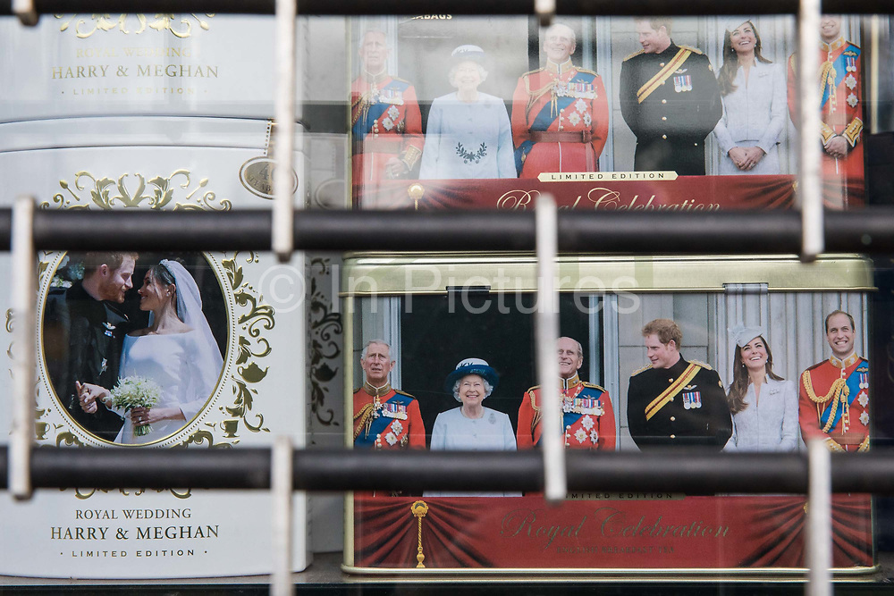 """Royal souvenirs are pictured in the window of a closed gift shop during the second coronavirus lockdown on 9th November 2020 in Windsor, United Kingdom. Only retailers selling """"essential"""" goods and services are permitted to open to the public during the second lockdown."""