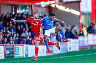 Accrington Stanley defender Nick Anderton (24) on loan from Blackpool, challenges Portsmouth defender Nathan Thompson (20)  during the EFL Sky Bet League 1 match between Accrington Stanley and Portsmouth at the Fraser Eagle Stadium, Accrington, England on 27 October 2018.