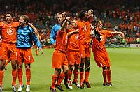 Team celebrate after final whistle<br />Holland EURO 2004<br />Holland v Latvia 23/06/04 EURO 2004 PORTUGAL<br />Photo Robin Parker Fotosports International
