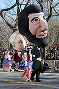 Balloon head costumes of Abraham Lincoln and George Washington in the Macy's Thanksgiving Parade.
