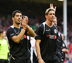 Fernando Torres and Luis Suarez acknowledge the crowd - Photo mandatory by-line: Dougie Allward/JMP - Mobile: 07966 386802 - 29/03/2015 - SPORT - Football - Liverpool - Anfield Stadium - Gerrard's Squad v Carragher's Squad - Liverpool FC All stars Game