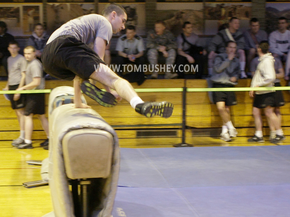 A cadet gets over the two hand vault obstacle at the start of the Indoor Obstacle Course Test at Hays Gym at the U.S. Military Academy at West Point on Feb. 9, 2010.