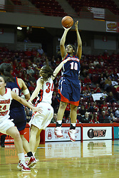 24 March 2011: Hannah Spanich arrives too late to stop a shot by Wumi Agunbiade during a WNIT (Women's National Invitational Tournament Women's basketball sweet 16 game between the Duquesne Dukes and the Illinois State Redbirds at Redbird Arena in Normal Illinois.