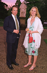 MR & MRS HUGO SWIRE he is the auctioneer, at a dinner in London on 24th May 1999.MSK 50