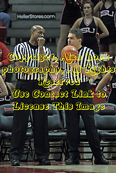 20 November 2013:  Referees James Ford and Paul Janssen during an NCAA Non-Conference mens basketball game between theJaspers of Manhattan and the Illinois State Redbirds in Redbird Arena, Normal IL