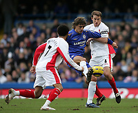 Photo: Lee Earle.<br /> Chelsea v Birmingham City. The Barclays Premiership.<br /> 31/12/2005.<br /> Chelsea's Hernan Crespo (C) holds off Jermaine Pennant (L) and Kenny Cunningham.