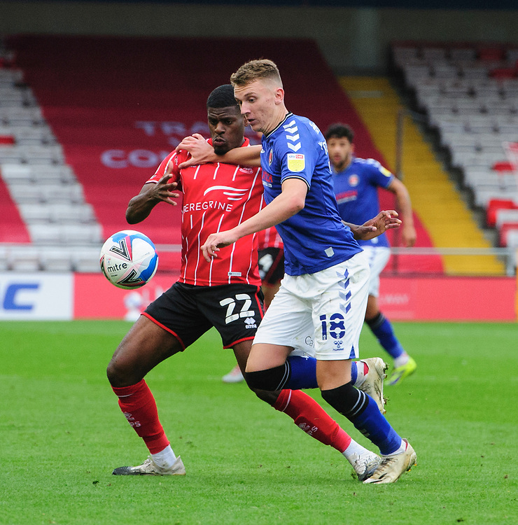 Lincoln City's Timothy Eyoma vies for possession with Charlton Athletic's Alfie Doughty<br /> <br /> Photographer Chris Vaughan/CameraSport<br /> <br /> The EFL Sky Bet League One - Lincoln City v Charlton Athletic - Sunday 27th September, 2020 - LNER Stadium - Lincoln<br /> <br /> World Copyright © 2020 CameraSport. All rights reserved. 43 Linden Ave. Countesthorpe. Leicester. England. LE8 5PG - Tel: +44 (0) 116 277 4147 - admin@camerasport.com - www.camerasport.com