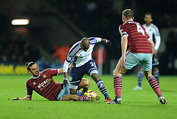 West Ham's Andy Carroll challenges for the ball with West Bromwich Albion's Youssuf Mulumbu - Photo mandatory by-line: Dougie Allward/JMP - Mobile: 07966 386802 - 02/12/2014 - SPORT - Football - West Bromwich - The Hawthorns - West Bromwich Albion v West Ham United - Barclays Premier League