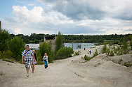 Rummu Quarry, Estonia - July 28, 2015: People visit Rummu quarry in Estonia. For many years the quarry was used as a mining site for Vasalemma marble (a kind of limestone). An adjacent Soviet-era prison supplied most of the workforce. When the quarry and prison closed, so did the pumps that kept the quarry free of rising ground water. Today it is a lake, and a popular place to swim and dive