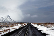 Huge clouds hang over the road along the southern coast of the Snaefellsnes Peninsular in Western Iceland
