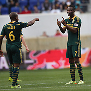 Darlington Nagbe, (left) and team mate Steve Zakuani, Portland Timbers, discuss tactics during the New York Red Bulls Vs Portland Timbers, Major League Soccer regular season match at Red Bull Arena, Harrison, New Jersey. USA. 24th May 2014. Photo Tim Clayton