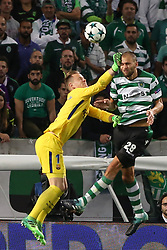 September 27, 2017 - Lisbon, Portugal - Barcelona's German gooalkeeper Marc-Andre ter Stegen fights for the ball with Sporting's forward Bas Dost from Holland (R ) during the UEFA Champions League football match Sporting vs Barcelona at the Alvalade stadium in Lisbon, Portugal on September 27, 2017. Photo: Pedro Fiuza  (Credit Image: © Pedro Fiuza/NurPhoto via ZUMA Press)