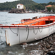 An old lifeboat on the beach of Skala Sykamias on the northern shores of Lesvos, Greece. Th majority of refugees and migrants use inflatable dinghies but in some cases the smugglers force people to use old boats that are farm more dangerours than the inflatable ones.