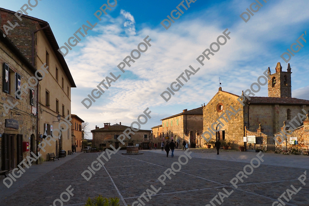 Piazza Roma of Monteriggione during the afternoon with few visitors