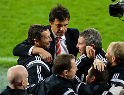 CARDIFF, WALES - Tuesday, October 13, 2015: Wales' manager Chris Coleman celebrates with assistant manager Osian Roberts and head of fitness and science Ryland Morgans after qualifying for the finals following a 2-0 victory over Andorra during the UEFA Euro 2016 qualifying Group B match at the Cardiff City Stadium. (Pic by Paul Currie/Propaganda)