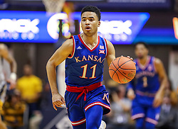 Jan 19, 2019; Morgantown, WV, USA; Kansas Jayhawks guard Devon Dotson (11) dribbles the ball up the floor during the first half against the West Virginia Mountaineers at WVU Coliseum. Mandatory Credit: Ben Queen-USA TODAY Sports