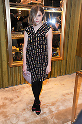 Actress CHLOE MORETZ at a Cocktail party to celebrate the opening of the new Miu Miu boutique, 150 New Bond Street, London hosted by Miuccia Prada and Patrizio Bertelli on 3rd December 2010.