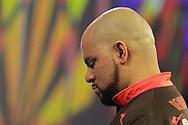 Devon Petersen contemplating his winning darts during the World Championship Darts 2018 at Alexandra Palace, London, United Kingdom on 17 December 2018.