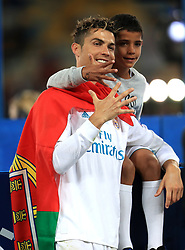 Real Madrid's Cristiano Ronaldo celebrates with his son after winning the UEFA Champions League Final at the NSK Olimpiyskiy Stadium, Kiev.