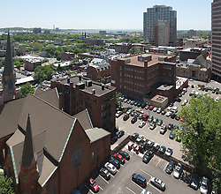 New Haven Skyline view Southeast from Wall Street to the Harbor. Vantage point roof of NH County Courthouse. Trinity Lutheran Church in foreground, 360 State Street Building and Harbor Station in distance. Perspective Correction.