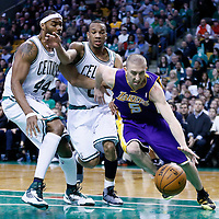 07 February 2013: Los Angeles Lakers point guard Steve Blake (5) drives past Boston Celtics power forward Chris Wilcox (44) and Boston Celtics point guard Avery Bradley (0) during the Boston Celtics 116-95 victory over the Los Angeles Lakers at the TD Garden, Boston, Massachusetts, USA.