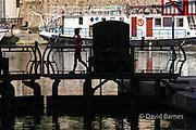 France, Paris (75), L'Ecluse de l'Arsenal, Woman crossing the locks between the River Seine and the Port de Plaisance .