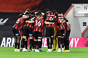 Bournemouth players huddle before kickoff during the EFL Sky Bet Championship match between Bournemouth and Nottingham Forest at the Vitality Stadium, Bournemouth, England on 24 November 2020.