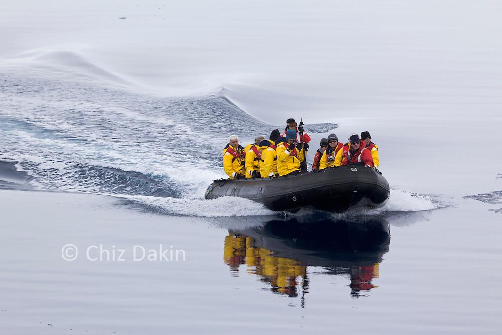 Kapitan Khlebnikov passengers return from Peter 1 Øy in fast Zodiacs, Phantom Coast, Western Antarctica