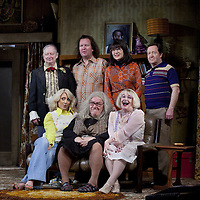 (l-r) Brian Pettifer, Paul Riley, Maureen Beattie and Jonathan Watson <br /> (front)  Louise McCarthy, Gregor Fisher and Barbara Rafferty.<br /> <br /> Yer Granny - a new production by The National Theatre of Scotland opens at the Beacon arts Centre, Greenock, Scotland.<br /> <br /> <br /> Based on La Nona by Roberto Cossa<br /> In a new version by Douglas Maxwell<br /> Directed by Graham McLaren<br /> <br /> <br /> Picture by Drew Farrell<br /> Tel : 07721-735041<br /> Image offered on a speculative basis.<br /> <br /> Yer Granny is a riotous new comedy about a diabolical 100-year-old granny who's literally eating her family out of house and home. She's already eaten their fish and chip shop into bankruptcy and now she's working her way through their kitchen cupboards, pushing the Russo family to desperate measures just to survive beyond 1977.<br /> <br /> As proud head of the family, Cammy is determined that The Minerva Fish Bar will rise again and that family honour will be restored – and all in time for the Queen's upcoming Jubilee visit. But before Cammy's dream can come true and before Her Maj can pop in for a chat, a single sausage and a royal seal of approval, the family members must ask themselves how far they will go to solve a problem like Yer Granny.<br /> <br /> Adapted from the smash-hit Argentinian comedy classic La Nona, the cast of Yer Granny features some of Scotland's best-loved performers, including Gregor Fisher in the title role, alongside Paul Riley (Still Game), Jonathan Watson (Only An Excuse?), Maureen Beattie (Casualty), Barbara Rafferty (Rab C Nesbitt), Brian Pettifer (The Musketeers) and Louise McCarthy (Mamma Mia!, West End).<br /> <br /> Performance dates :<br /> The Beacon Arts Centre, Greenock<br /> 19/05/2015-21/05/2015 <br /> <br /> King's Theatre, Glasgow<br /> 26/05/2015-30/05/2015 <br /> <br /> King's Theatre, Edinburgh<br /> 02/06/2015-06/06/2015 <br /> <br /> Eden Court, Inverness<br /> <br /> Lyric Theatre, Belfast<br /> 23/0