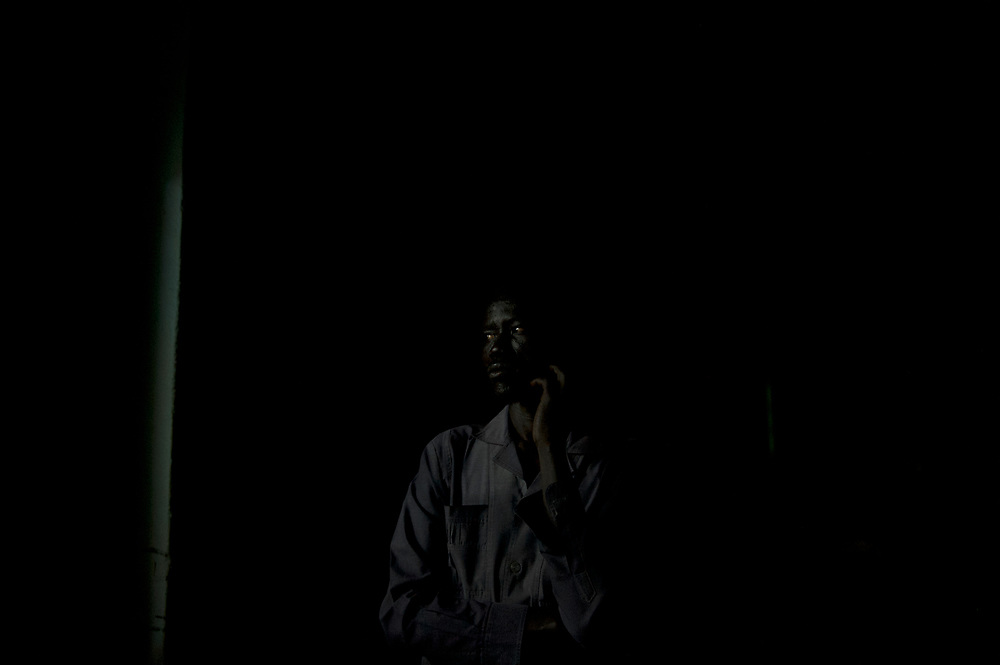 An elections monitor from the African Union, watches the counting of the votes of the referendum for independence of South Sudan, at a polling station in central Juba.