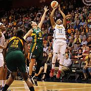 Alex Bentley, (right), Connecticut Sun, shoots over Sue Bird, Seattle Storm, during the Connecticut Sun Vs Seattle Storm WNBA regular season game at Mohegan Sun Arena, Uncasville, Connecticut, USA. 23rd May 2014. Photo Tim Clayton