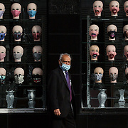 "A man wearing a mask walks past a Glasgow shop selling masks. Today there is an anti-Coronavirus Act protest in George Square, Glasgow.A group of people is expected to gather in George Square to ""protest for their rights back"". <br /> <br /> Picture Robert Perry 30th August 2020<br /> <br /> Must credit photo to Robert Perry<br /> FEE PAYABLE FOR REPRO USE<br /> FEE PAYABLE FOR ALL INTERNET USE<br /> www.robertperry.co.uk<br /> NB -This image is not to be distributed without the prior consent of the copyright holder.<br /> in using this image you agree to abide by terms and conditions as stated in this caption.<br /> All monies payable to Robert Perry<br /> <br /> (PLEASE DO NOT REMOVE THIS CAPTION)<br /> This image is intended for Editorial use (e.g. news). Any commercial or promotional use requires additional clearance. <br /> Copyright 2018 All rights protected.<br /> first use only<br /> contact details<br /> Robert Perry     <br /> <br /> no internet usage without prior consent.         <br /> Robert Perry reserves the right to pursue unauthorised use of this image . If you violate my intellectual property you may be liable for  damages, loss of income, and profits you derive from the use of this image."