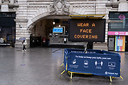 The day after the government introduced a third Coronavirus pandemic national lockdown, effectively a Tier 5 restriction, face coverings remain mandatory on public transport and Victoria mainline station, as the capital experiences a grim post-Christmas and millions of Britons are told to stay at home, on 5th January 2021, in London, England.