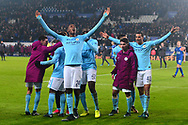 Tosin Adarabioyo of Manchester City, Yaya Toure of Manchester City (42) and Lukas Nmecha of Manchester City celebrate with team mates after they win the game in a penalty shootout .Carabao Cup quarter final match, Leicester City v Manchester City at the King Power Stadium in Leicester, Leicestershire on Tuesday 19th December 2017.<br /> pic by Bradley Collyer, Andrew Orchard sports photography