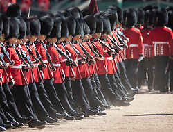 © Licensed to London News Pictures. 13/05/2019. London, UK. Guardsmen kick up dust as they take part in rehearsals for Trooping of the Colour ceremony in bright sunshine in Horse Guards Parade. The ceremony - on June 8, 2019 - heralds the birthday of Queen Elizabeth II. Photo credit: Peter Macdiarmid/LNP