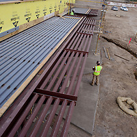 Concrete workers and other crewmen work on the facade of the new Ramah Elementary School in Ramah Wednesday.