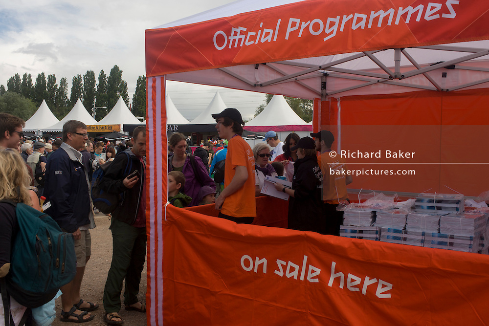 Selling official Olympic programmes before the start of the canoe slalom heats at the Lee Valley White Water Centre, north east London, on day 3 of the London 2012 Olympic Games. Costing £10, the Official Programme also includes the competition schedule and a comprehensive A-Z of all 26 Olympic sports. Only available at official shops and London 2012 competition venues, this is the ultimate guide to the Games. A4 size approx 196 pages.