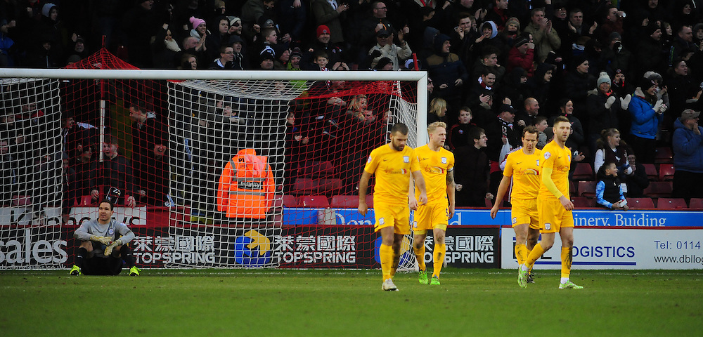 Preston North End's Thorsten Stuckmann, left, looks dejected after Sheffield United's Marc McNulty scored the opening goal <br /> <br /> Photographer Chris Vaughan/CameraSport<br /> <br /> Football - The Football League Sky Bet League One - Sheffield United v Preston North End - Saturday 10th January 2015 - Bramall Lane - Sheffield<br /> <br /> © CameraSport - 43 Linden Ave. Countesthorpe. Leicester. England. LE8 5PG - Tel: +44 (0) 116 277 4147 - admin@camerasport.com - www.camerasport.com