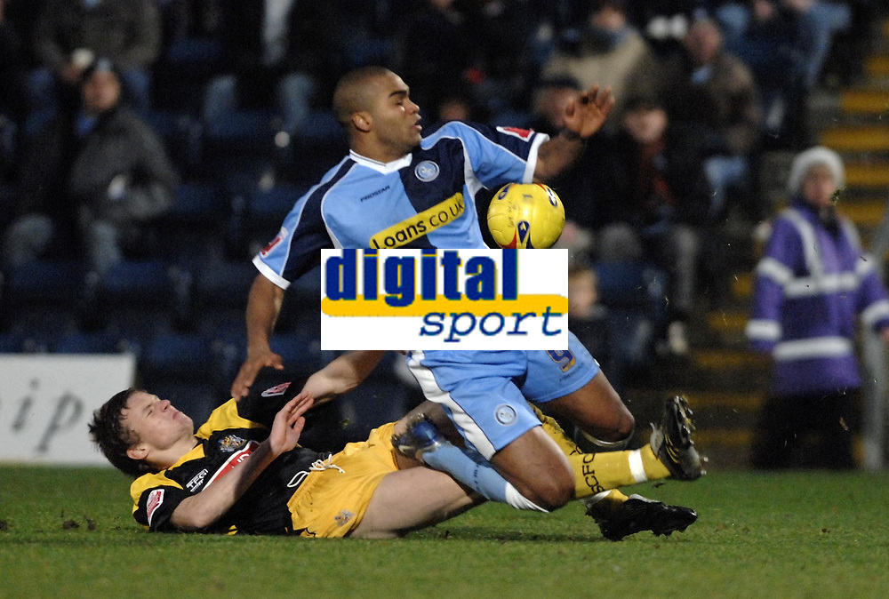Photo: Richard Lane.<br />Wycombe Wanderers v Stockport County. Coca Cola League 2. 23/12/2006. <br />Wycombe's Jermaine Easter is brought doewn by Stockport's James Tunnicliffe.