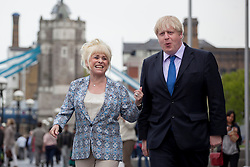 © licensed to London News Pictures. London, UK 07/05/2013. Mayor of London Boris Johnson and EastEnders star Barbara Windsor posing outside City Hall to promote the Big Lunch. Photo credit: Tolga Akmen/LNP