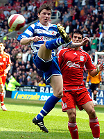Photo: Ed Godden/Sportsbeat Images.<br />Reading v Liverpool. The Barclays Premiership. 07/04/2007. Reading's John Oster (L), is approached from behind by Mark Gonzalez.