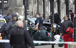 EDS NOTE CONTENT Emergency personnel close to the Palace of Westminster, London, after policeman has been stabbed and his apparent attacker shot by officers in a major security incident at the Houses of Parliament.