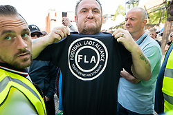 © Licensed to London News Pictures . 19/05/2018. Manchester, UK. FLA supporters gesture at counter-protesting Stand Up to Racism supporters at Castlefield Bowl . The Football Lads Alliance demonstrate in Manchester , three days before the first anniversary of the Manchester Arena terror attack . Photo credit: Joel Goodman/LNP
