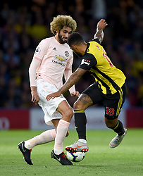 Manchester United's Marouane Fellaini (left) and Watford's Andre Gray battle for the ball