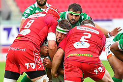 Marco Fuser of Benetton Treviso is tackled by Blade Thomson and Ken Owens of Scarlets<br /> <br /> Photographer Craig Thomas/Replay Images<br /> <br /> Guinness PRO14 Round 3 - Scarlets v Benetton Treviso - Saturday 15th September 2018 - Parc Y Scarlets - Llanelli<br /> <br /> World Copyright © Replay Images . All rights reserved. info@replayimages.co.uk - http://replayimages.co.uk