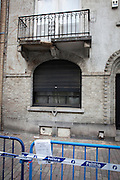 """Police tape surrounding damaged balcony, Rue Vanderkindere, Brussels. This balconay has been """"collapsing"""" for months now. There was some pallets around it, warn off people from walking under it. Then it got a sudden upgrade to police tape, and an advertisement for bouncy castles. N'importe quoi."""