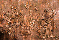 A copper bas-relief of Uyghurs dancing. Turpan, Xinjiang Province, China. Uyghur people are a Central Asian people of Muslim Turkic origin. They are China's largest minority group.