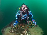 Scuba diver on the top of Silver Comet with the sign NYUPD at Dutch Springs, Bethlehem