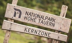 THEMENBILD - die Kernzone des Nationalpark Hohe Tauern wird mit einem Holzschild in der Nähe des Hintersees marktiert. Der Hintersee ist ein kleiner Gebirgssee in 1313 m Höhe im Talschluss des Felbertals in Mittersill. Der Bergsee ist ein Naturdenkmal und wurde unter Schutz gestellt. Der Hintersee gilt als Geheimtipp, Erholungsgebiet und ein Platz, den man gesehen haben muss, aufgenommen am 23. Juni 2019, am Hintersee in Mittersill, Österreich // The core zone of the Hohe Tauern National Park is marked with a wooden sign near the Hintersee lake. Hintersee is a small mountain lake 1313 m above sea level at the end of the Felbertal valley in Mittersill. The mountain lake is a natural monument and was placed under protection. The Hintersee is an insider tip, a place you must have seen and a recreation area on 2019/06/23, Hintersee in Mittersill, Austria. EXPA Pictures © 2019, PhotoCredit: EXPA/ Stefanie Oberhauser