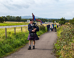 Musselburgh, East Lothian, Scotland, UK, Battle of Pinkie Cleugh commemoration: the annual ceremony takes place in a new format with live streaming as well as actual participation. The 473rd anniversary of the significant battle in Scotland's 'Rough Wooing' history is marked by a battle trail walk organised by the Pinkie Cleugh Battlefield Group ending at the memorial stone and a minute's silence for the 10,000 Scots killed on a day known as 'Boody Saturday'.  The battle was the largest ever fought in Scotland and resulted in a defeat for the Scots. Pictured: piper Colin Pryde leads the walkers along the heritage battle trail.<br /> Sally Anderson | EdinburghElitemedia.co.uk